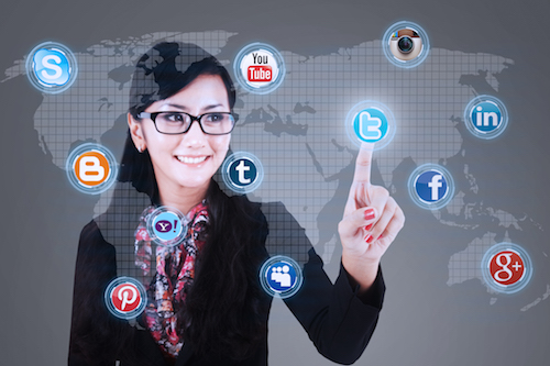Close-up of businesswoman touching social media application