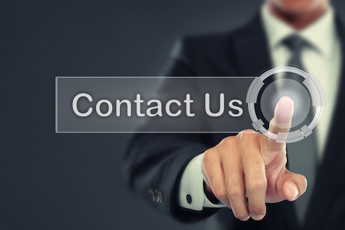 portrait of Businessman push to Contact Us button on virtual screen