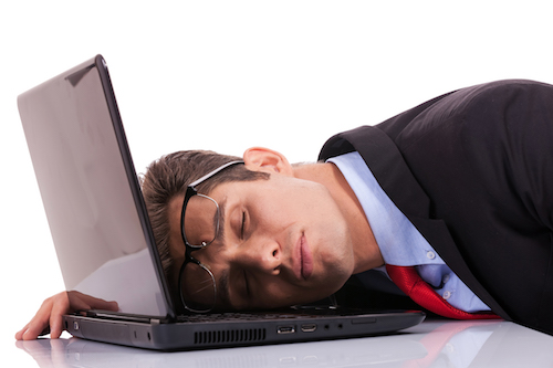 Tired business man sleeping on his laptop computer